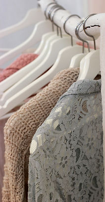 clothes hanging on white rack_edited.jpg