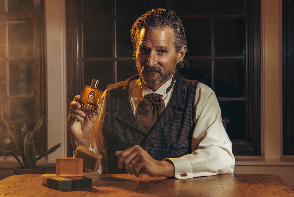 middle age male model holding cologne