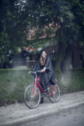 Woman Bicycling in rain poncho Amazon Product Photography
