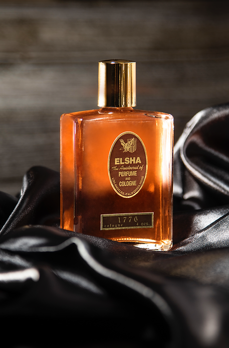 elsha cologne perfume on black silk