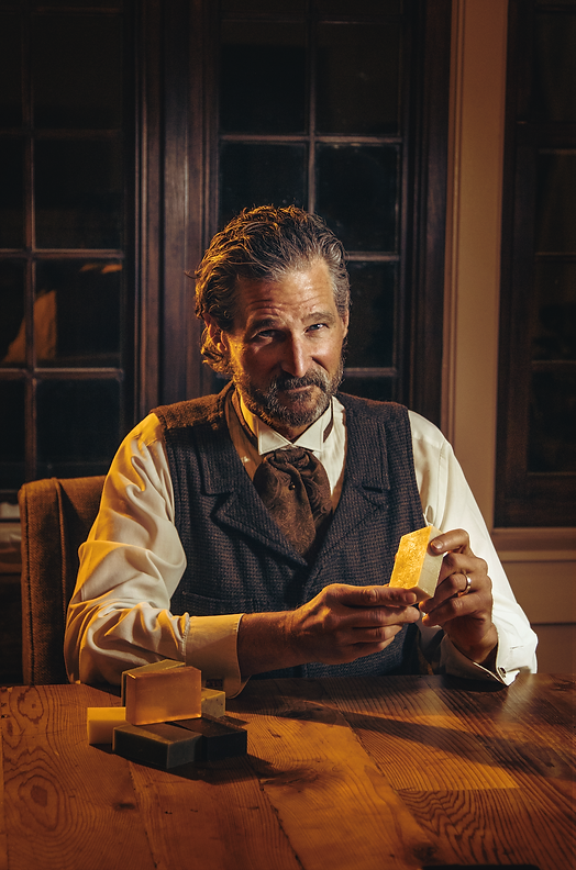 middle age male model holding soap bars western theme