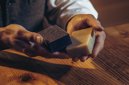 middle age rough male hands holding soap bars