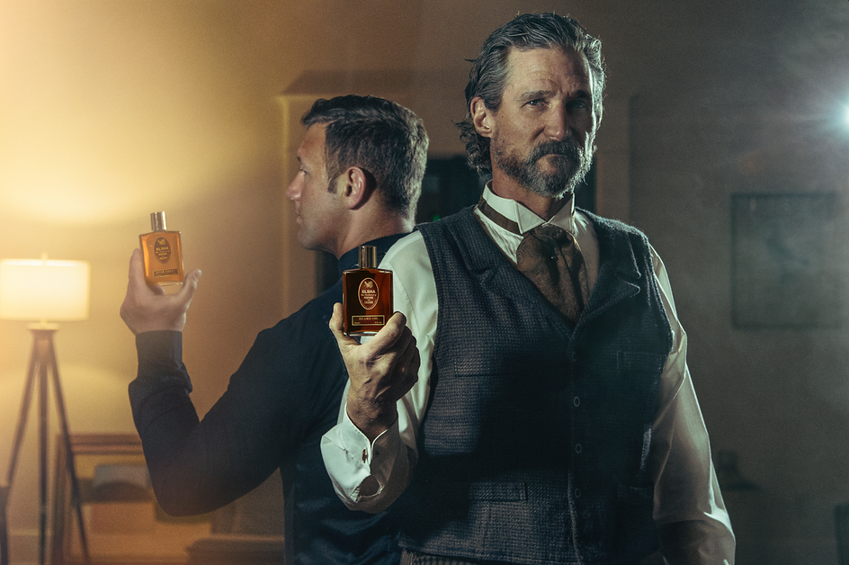 young male and middle age western male models holding bottles of cologne