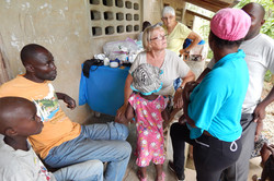 2016 - Shelly Sims consulting with patients in an outdoor clinic
