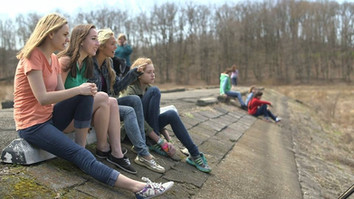 Girls on pier at Glade Run Lake (prior to the lake being filled in).