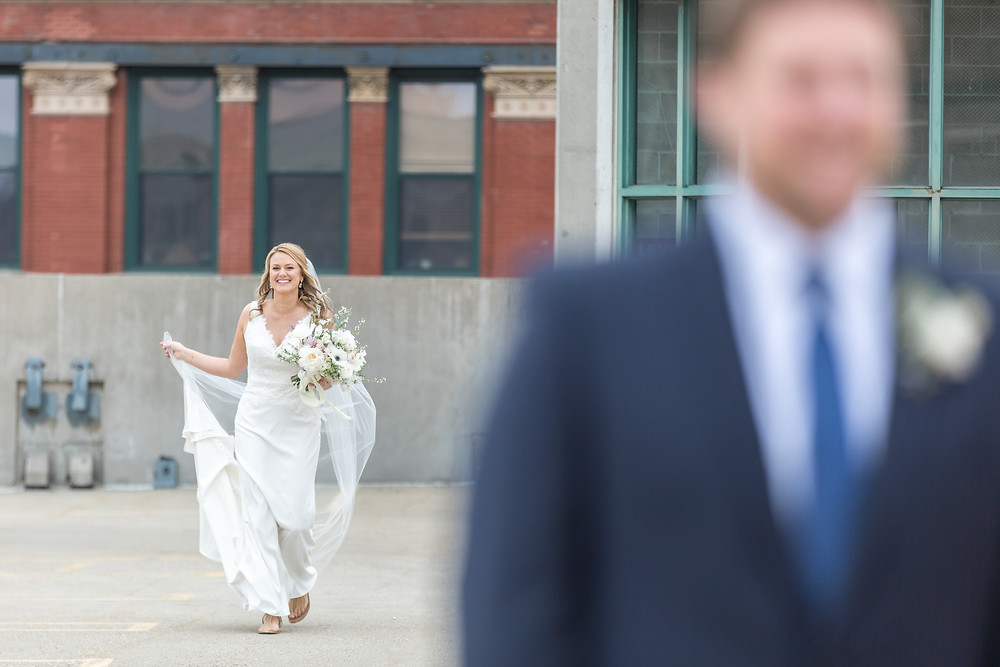 """Laura, the bride, striding toward her groom for their """"first look."""" Photo by Lottie Lillian."""