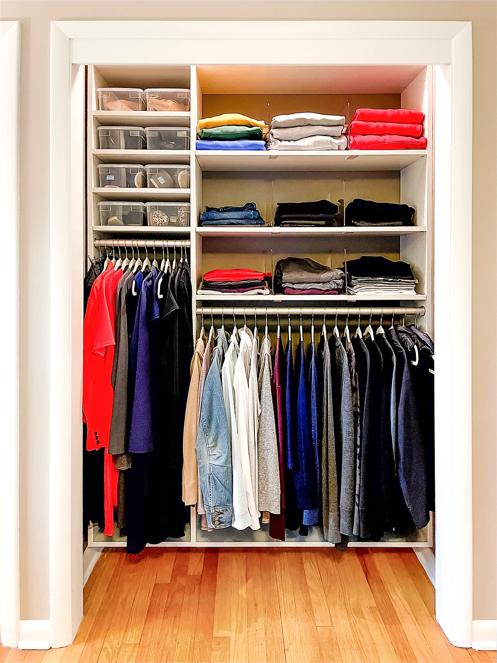 Similar types and colors of clothing stored neatly together.
