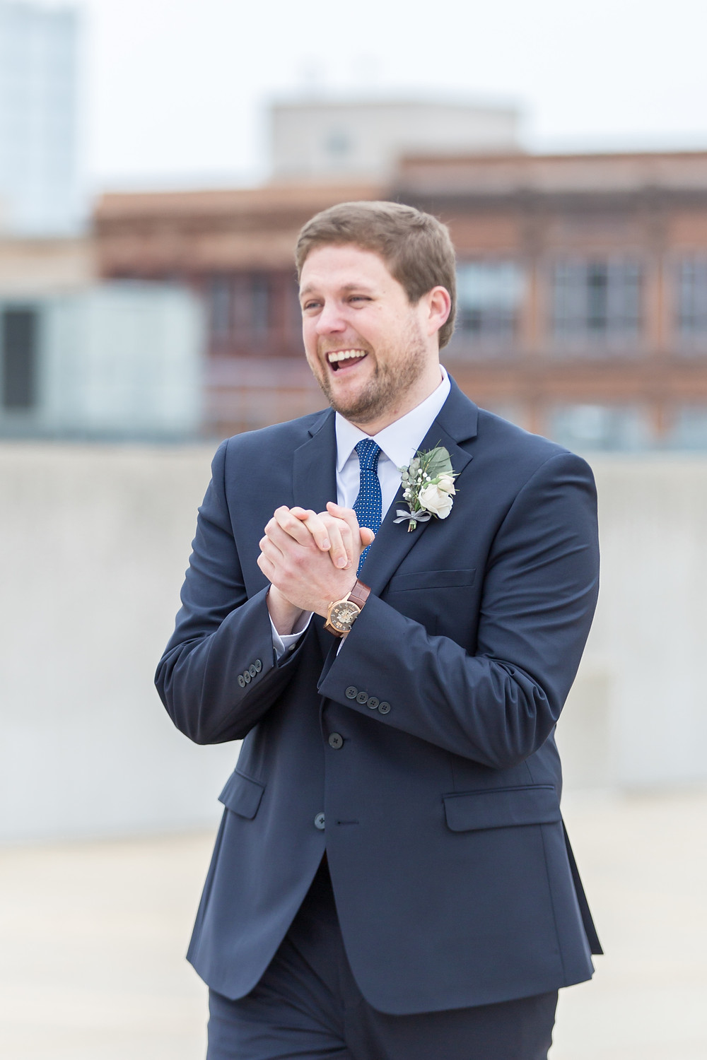 """Erik, the groom, overjoyed upon seeing his bride at their """"first look"""" on their wedding day. Photo by Lottie Lillian."""
