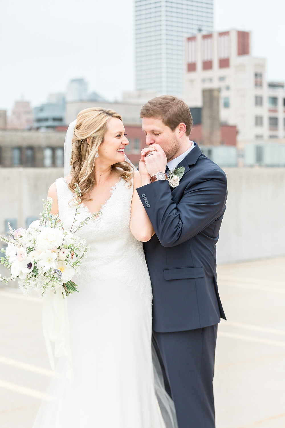 """Bride and groom united at their """"first look"""" on their wedding day. Photo by Lottie Lillian."""