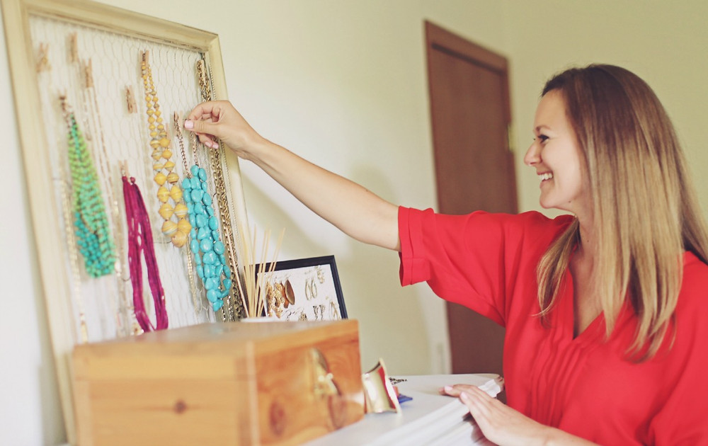 Laura organizing her necklaces