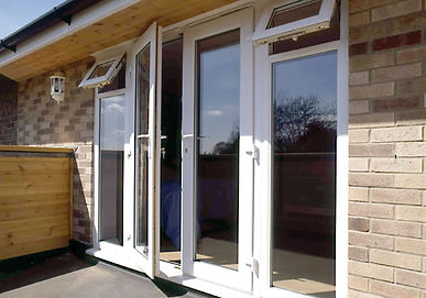 Double glazed french doors and side panels white PVCU