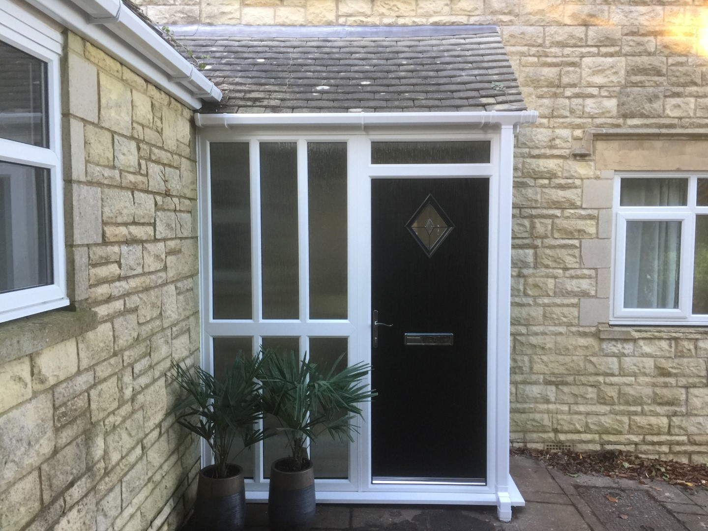 Composite front door and side panels