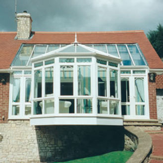 White PVCU double glazing and glass roof