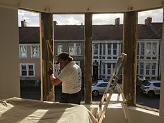 Man fitting double glazing windows