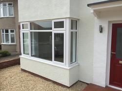 Bay window and red composite door