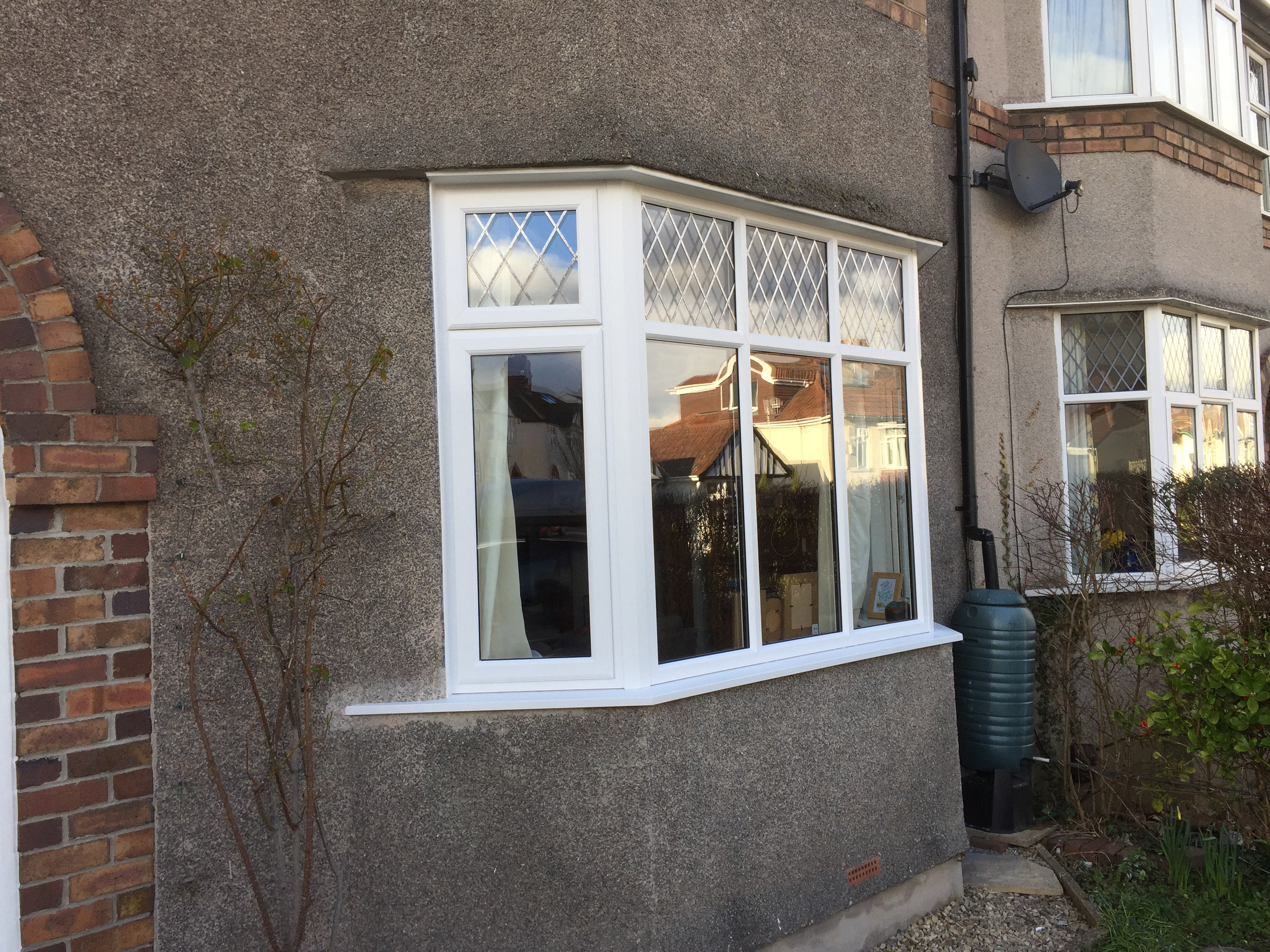 New bay windows x 2, double glazed