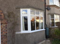 New bay windows x 2, double glazed