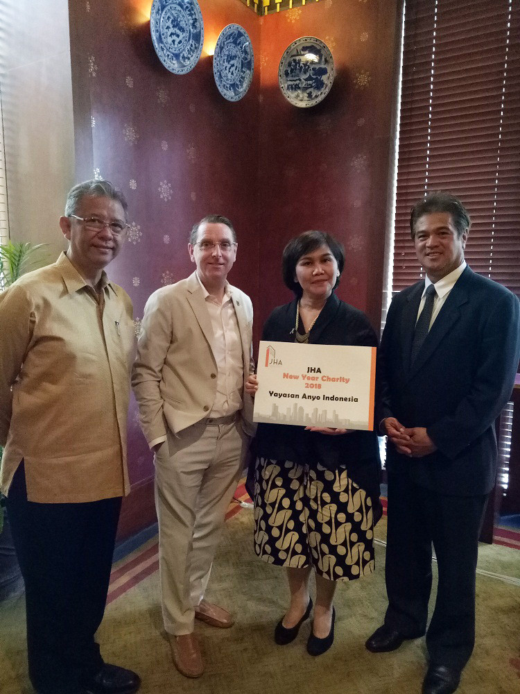 Yayasan Anyo Indonesia receiving donation from JHA with Mr. Chairman and Vice Chairman on each side