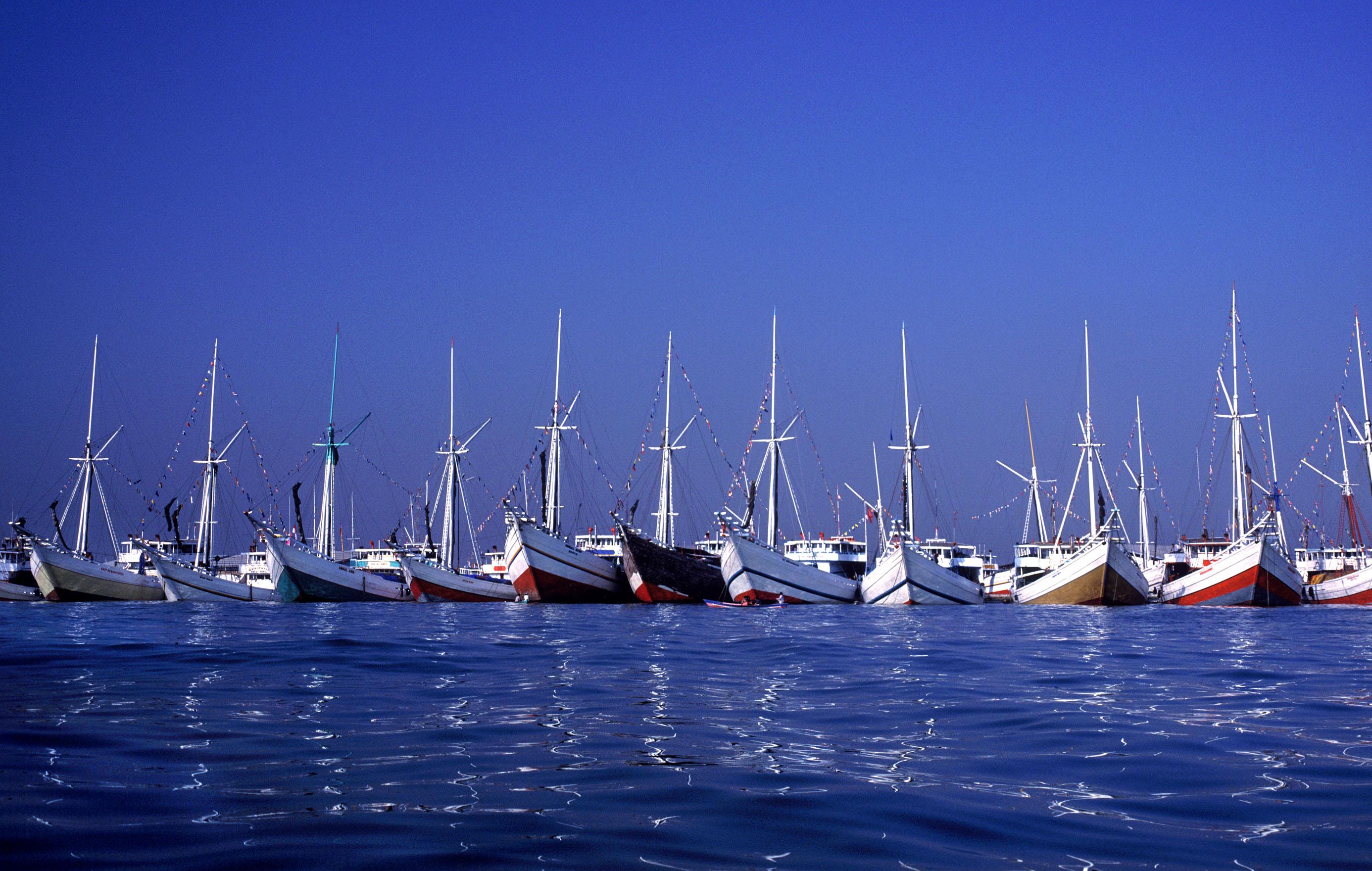 LM-015 Line-up of wooden Phinisi boats at Sunda Kelapa Port 1- North Jakarta