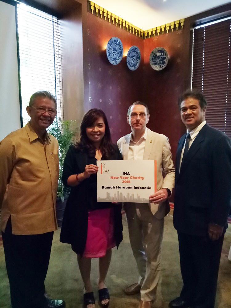 Rumah Harapan Indonesia receiving a donation handed over by Mr. Darrel Cartwright as JHA Vice Chairman
