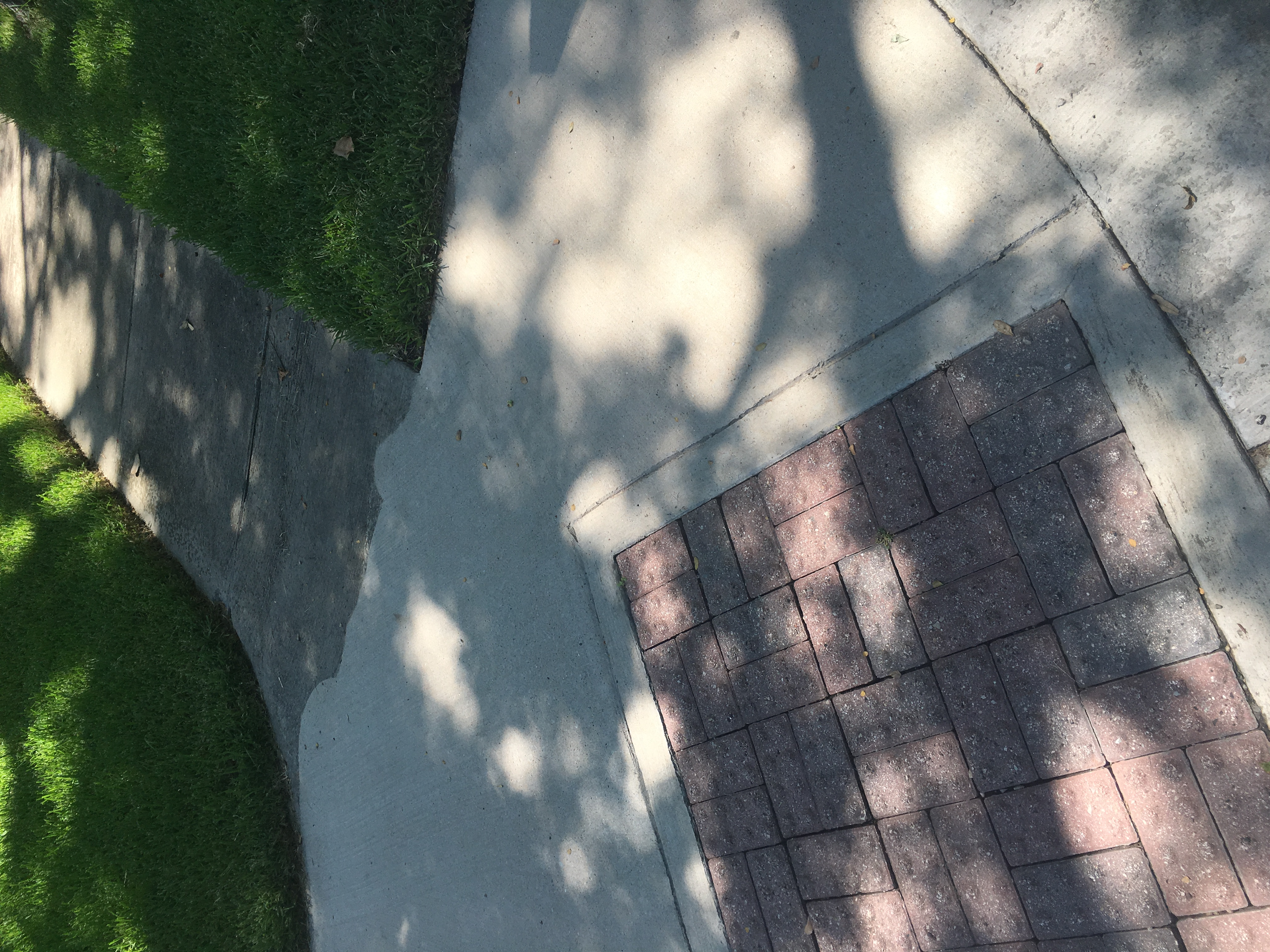 Pressure washing sidewalk