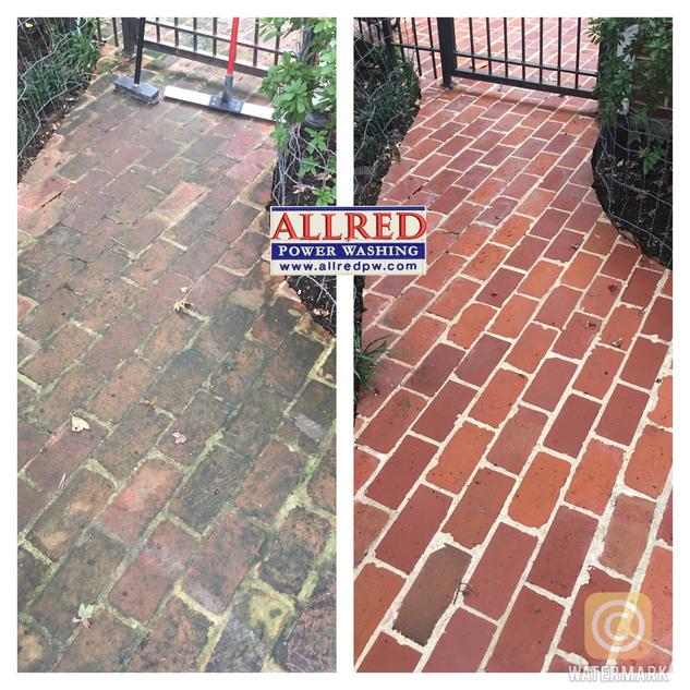 Power washing brick walkway to clean