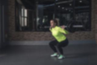 woman-lifting-barbell-371049.jpg