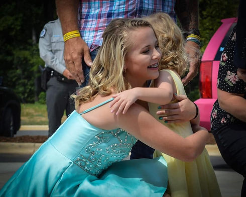 Mackenzie & Ally hugging.JPG