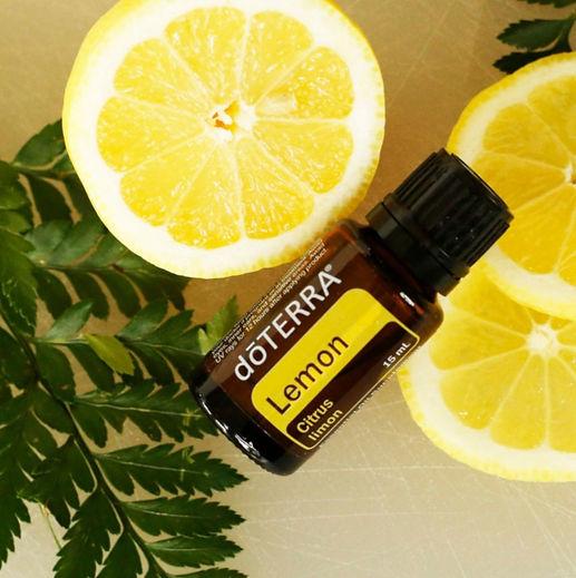 Lemons and leaves with lemon essential oiil