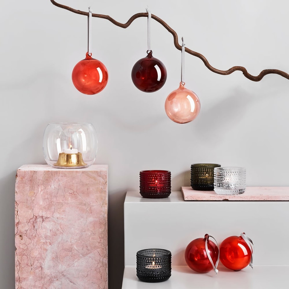 The decorative glass balls are mouth-blown, quick, and inexpensive to make, which fits a larger-scale production.