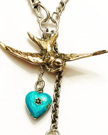 Swallow, blue heart