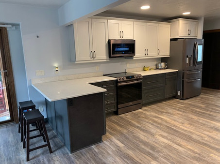 US Cabinet Depot: Shaker Cinder & Shaker Dove. MSI Quartz: Carrara Mist. Eternity Flooring: Ashbury WPC
