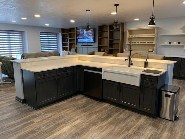 US Cabinet Depot: Shaker Cinder. MSI Quartz: Carrara Mist. Romano Italian Fireclay Sink. Eternity Flooring: Ashbury WPC