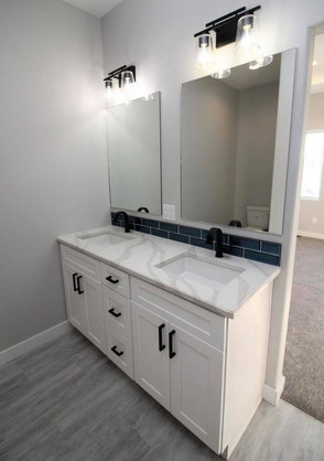 US Cabinet Depot: White Shaker cabinets. MSI Quartz: Calacatta Luccia. Eternity Flooring: Legacy Pearl