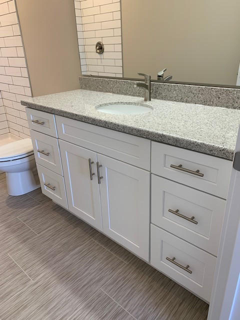 US Cabinet Depot: Shaker White. Radianz Quartz: Sierra Bedrock. Continental Porcelain Sink. Elements Hardware: Naples Pulls