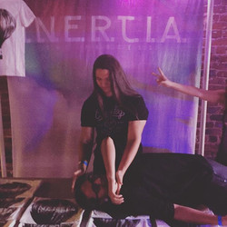 Our guitarist _minotaurean trying to sacrifice our bass player _corps_661 at our merch table