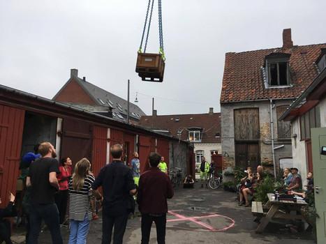 Delivery of beer via crane from the construction workers next door