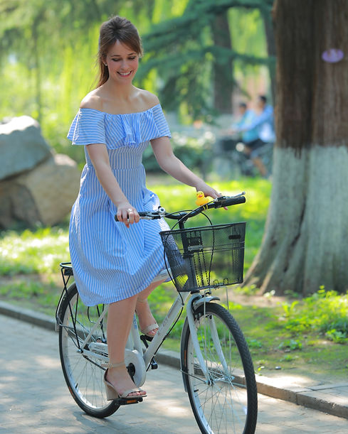 Natalie 2 - riding her bike on campus at