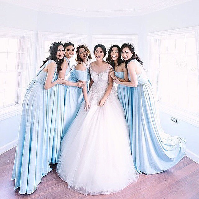 Gorgeous bridesmaids wearing our custom serenity powder blue infinity gowns 💙thank you _mrsdaqzmen,