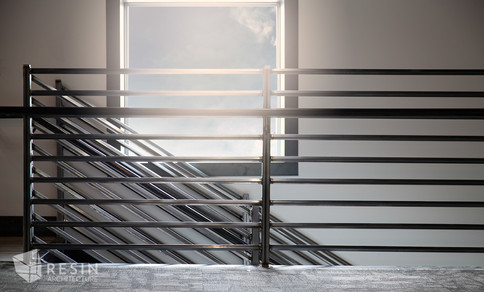 Custom made railings for the stairs at Total Trailer Co. in Idaho Falls.