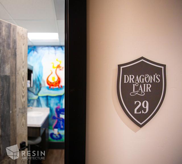 Custom Dragon's Lair sign outside exam room 29 at Idaho Falls Pediatrics.