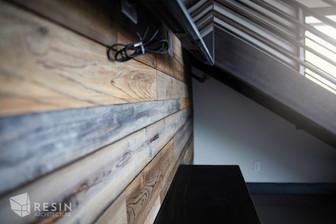Custom barn wood wall cladding inside Total Trailer Co. in Idaho Falls.