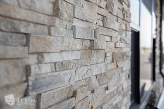 Detail shot of the stone exterior of Elite Auto Sales in Idaho Falls.