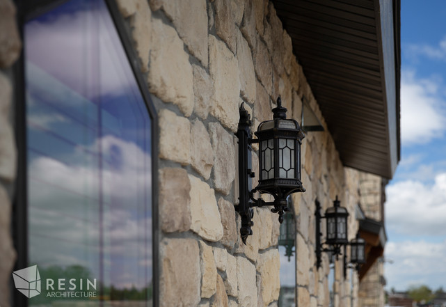 Up close detail of the stone work, windows, and sconces on the exterior of Idaho Falls Pediatrics.