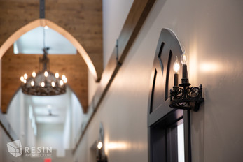 Interior sconces with candle light bulbs.