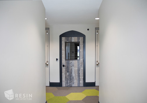 Custom wood interior doors made to look aged from a castle at Idaho Falls Pediatrics.