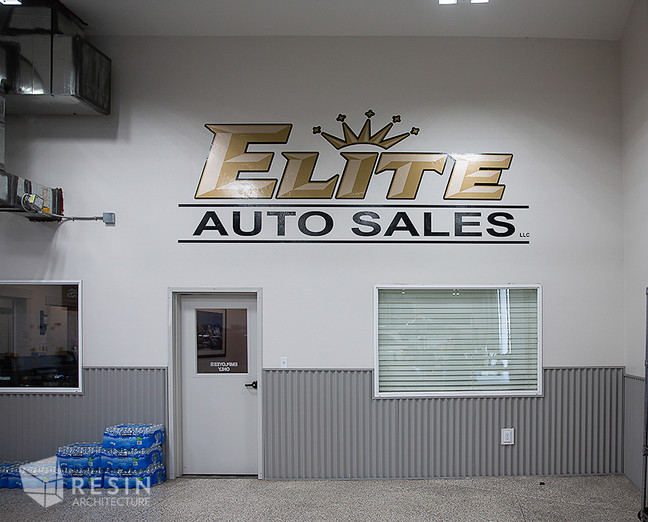 Image of the Elite Auto Sales logo above the door to the office area inside Elite Auto Sales in Idaho Falls.