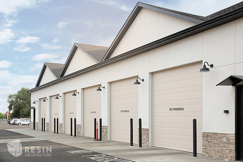 Angled view of the bay doors of Elite Auto Sales in Idaho Falls.