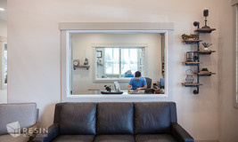 Image of an office through a window inside Elite Auto Sales in Idaho Falls.