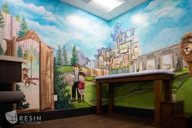 Custom medieval mural in one of the exam rooms at Idaho Falls Pediatrics.